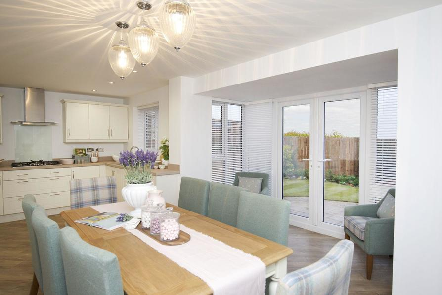 Typical Kennington dining and family area with glazed bay and French doors