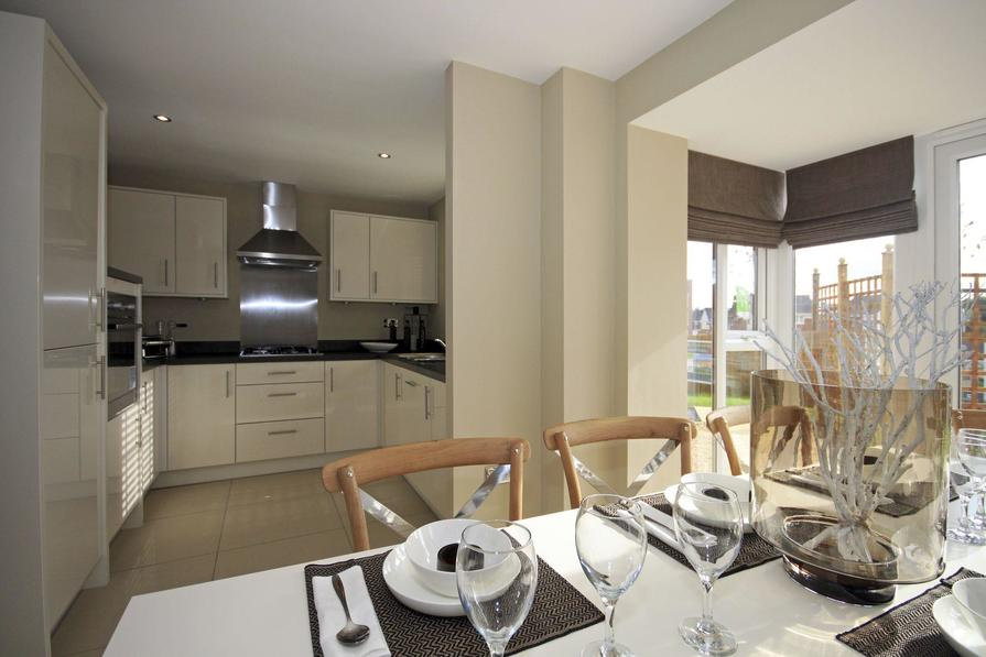 Typical Somerton kitchen and dining area with glazed bay window and French doors