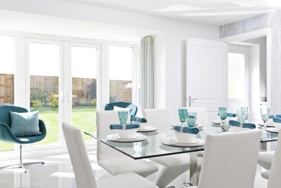 Typical Tetbury dining area with Freanch doors leading through to the utility