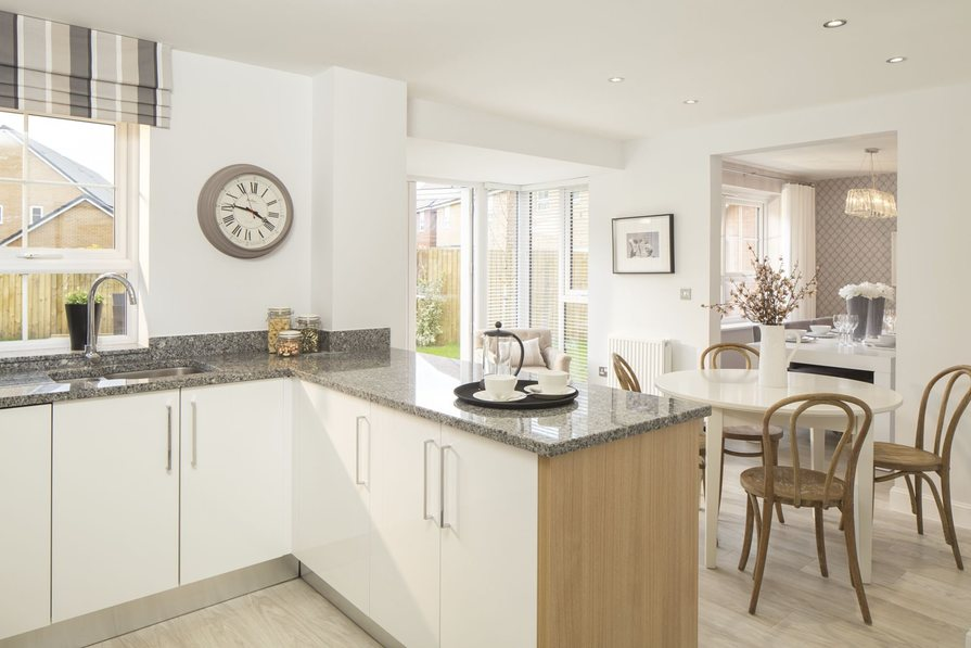 Typical Cambridge fitted kitchen leading to family and breakfast area
