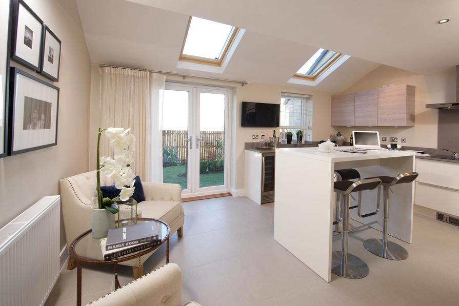 Open-plan kitchen with family/breakfast areas and French doors