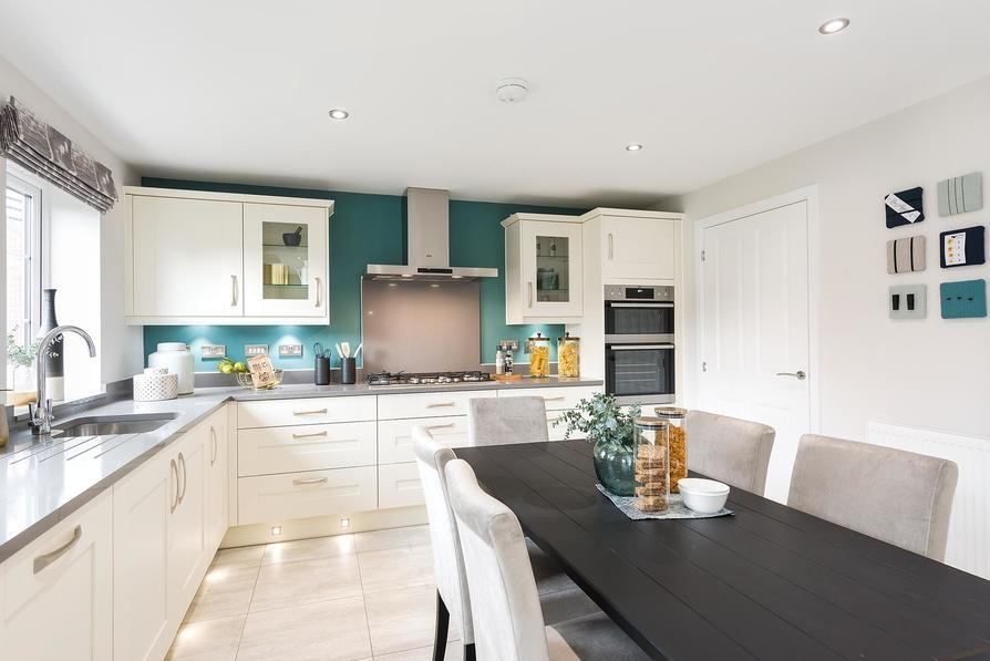 Open-plan kitchen with family/breakfast area