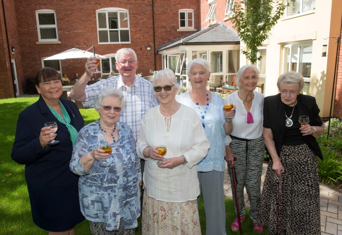 Homeowners enjoying a garden party
