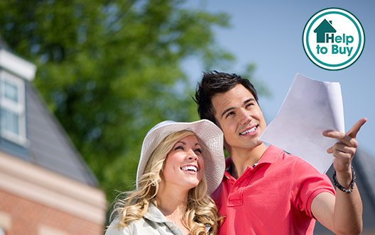young couple looking at new homes