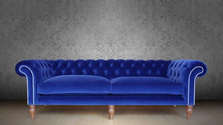 Blue velvet Chesterfield sofa