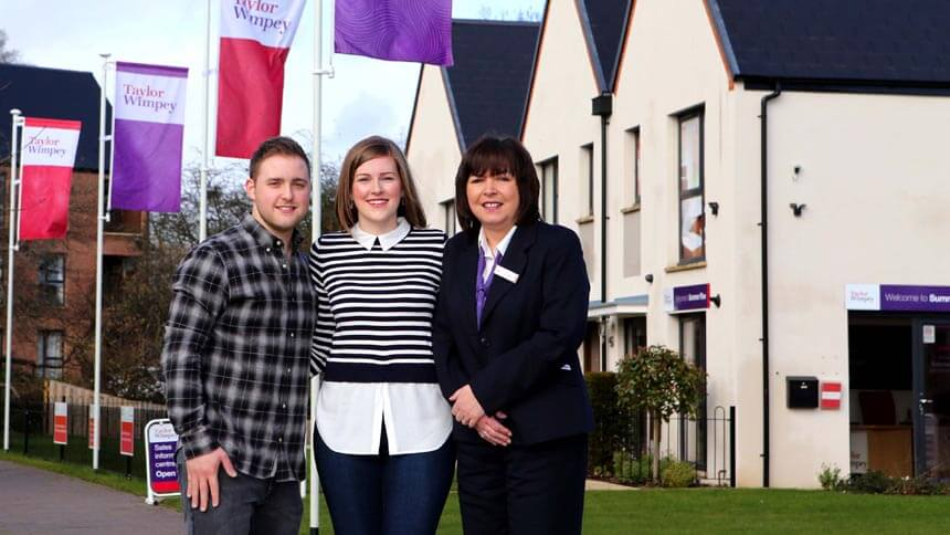 Samuel and Kathy with Taylor Wimpey's Vera Holmes