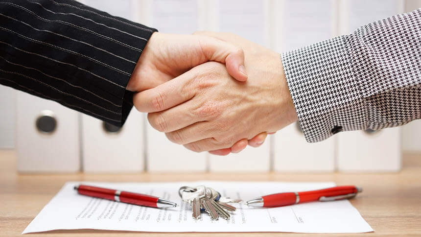 Two men shaking hands on a remortgage