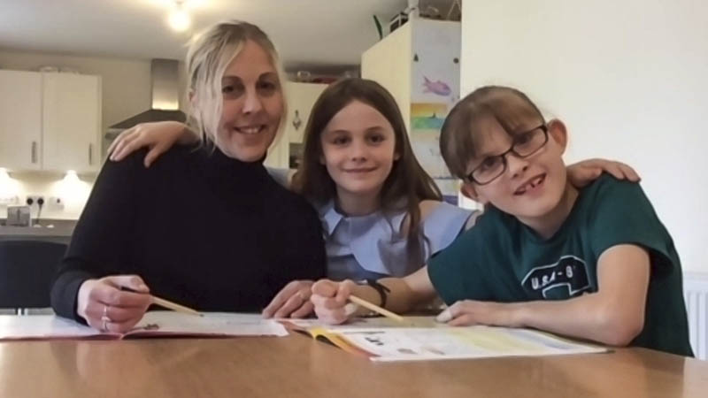 Emma, Amelia and Madeline Roberts at home