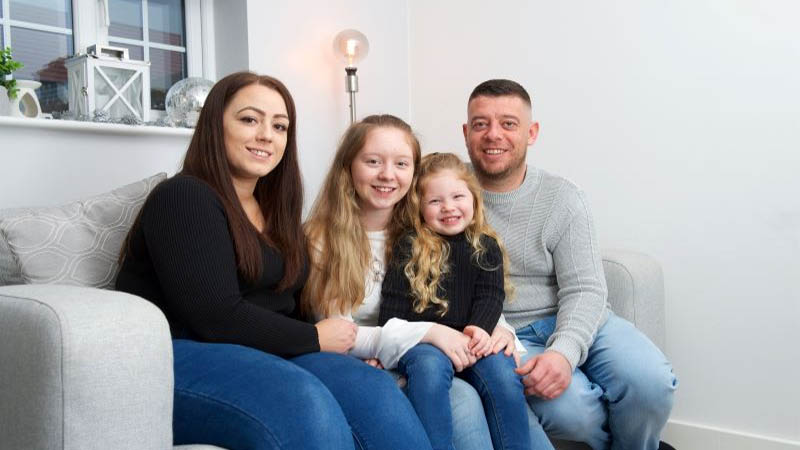 Katie and Barry with Grace and Sienna at home