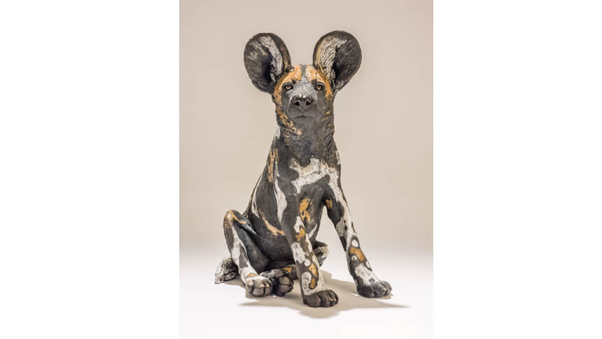 Wild dog ceramic sculpture by Nick Mackman