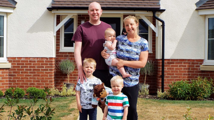 The family outside their new home