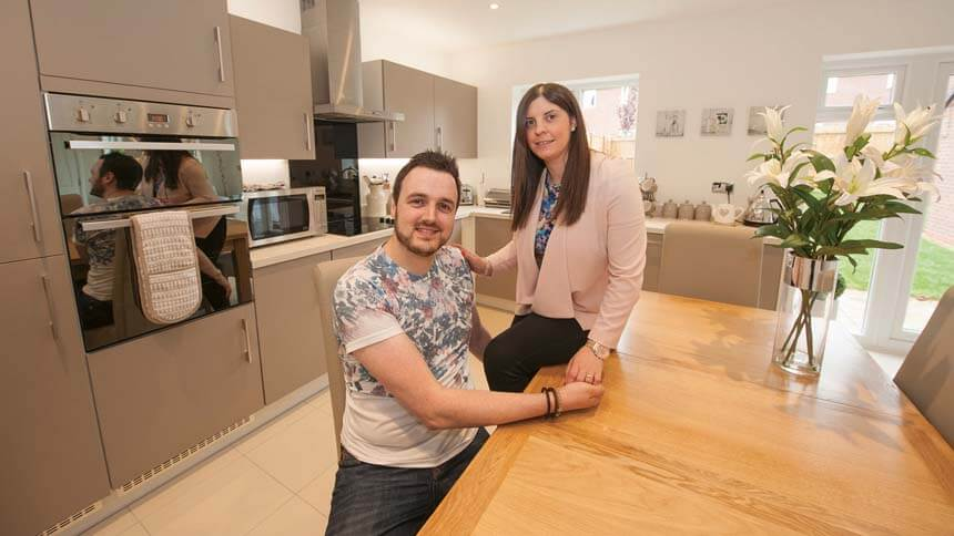 Chris and Laura in their new home