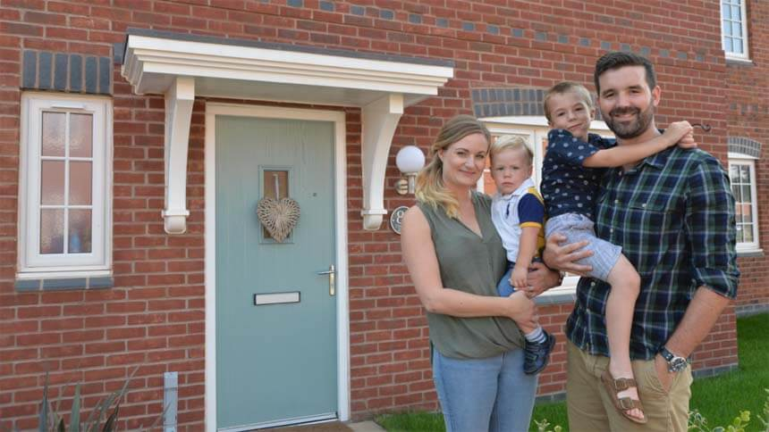 The Price family outside their new home