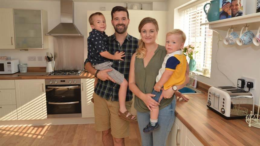 The Price family inside their new home