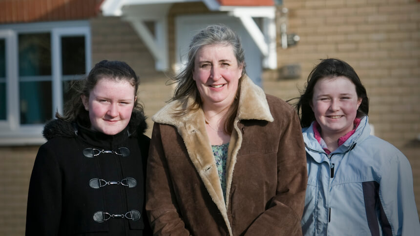 Sian and her daughters outside their home