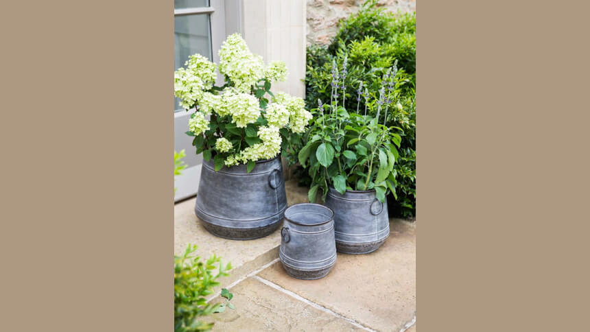 Three galvanised steel planters