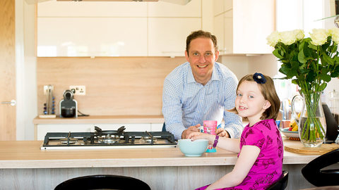 Alistair Hankin and his daughter in their new home