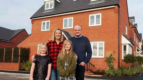 The Andrews' family outside their new home
