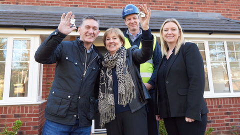 Phil and Marlene with the keys to their new home