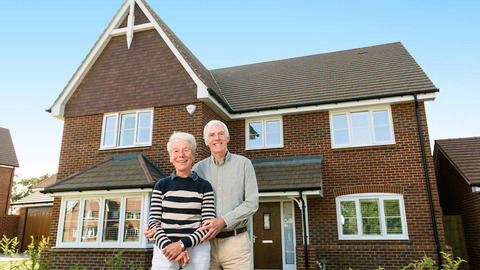 Rogan and Lesley outside their new home