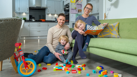 Adam, Holly and their children in their new home