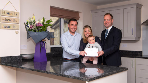 The Dodd family in their new home