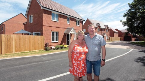 Neil and Vivienne outside their new home