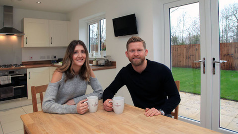Aaron and Laura in their new home