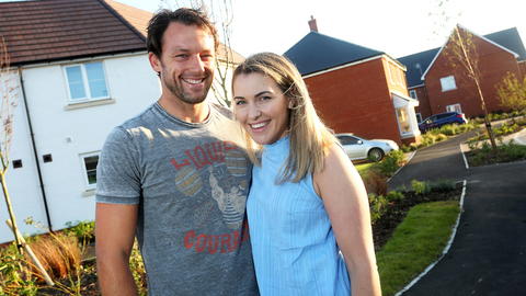 Matt and Claire outside their new home