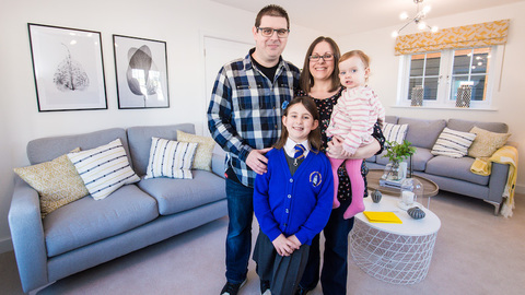 Simon and Anna with their family in their new home