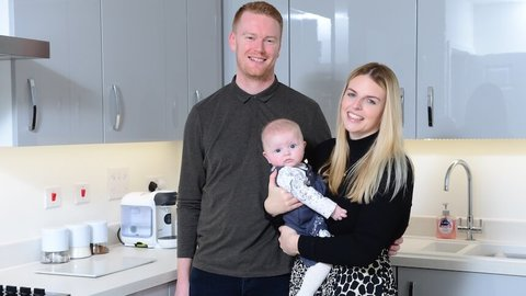 Sophie, Matt and their baby in their new home