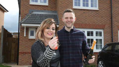 Sarah and Steve outside their new home