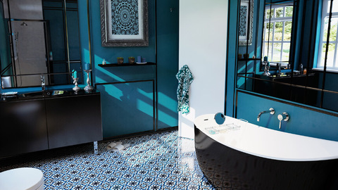 Dramatic teal and black bathroom