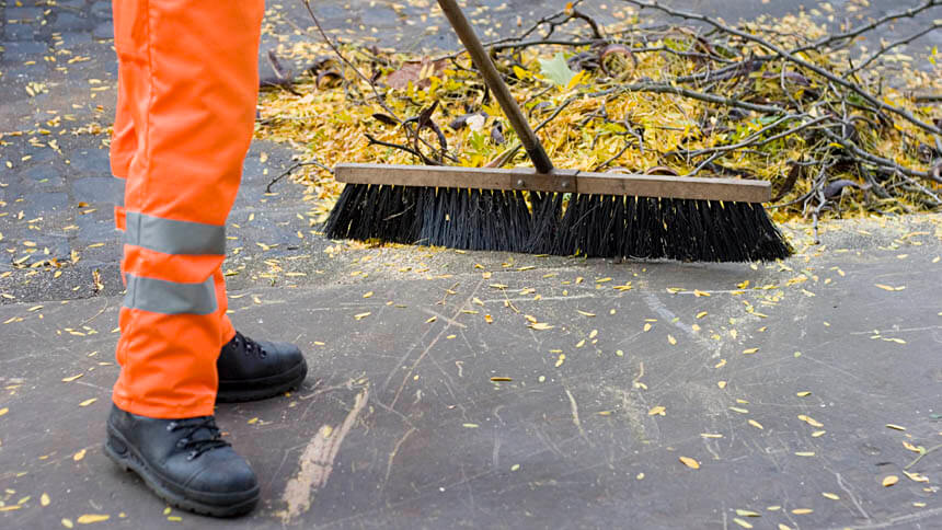 Service Charge: A maintenance man sweeping