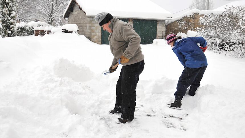 Neighbours helping shovel snow
