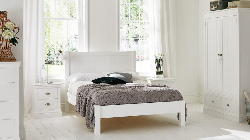 White wood bedframe helps to keep you cool