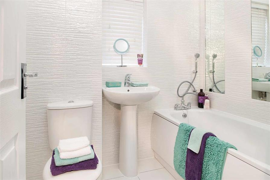 Photographs show a typical Taylor Wimpey home